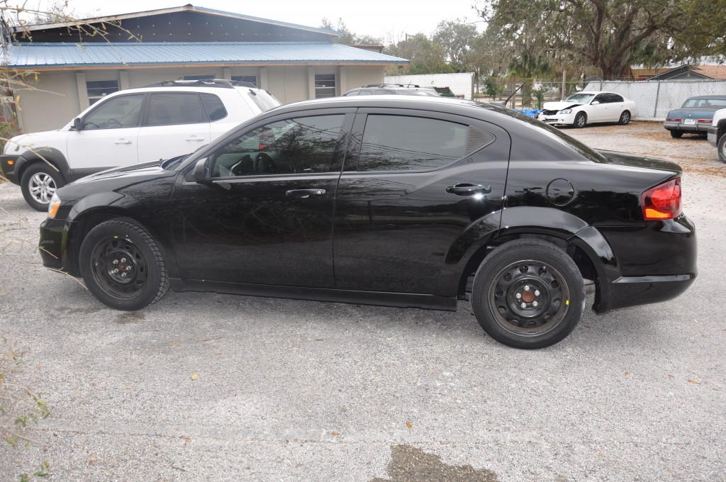 2011 Dodge Avenger side swipe