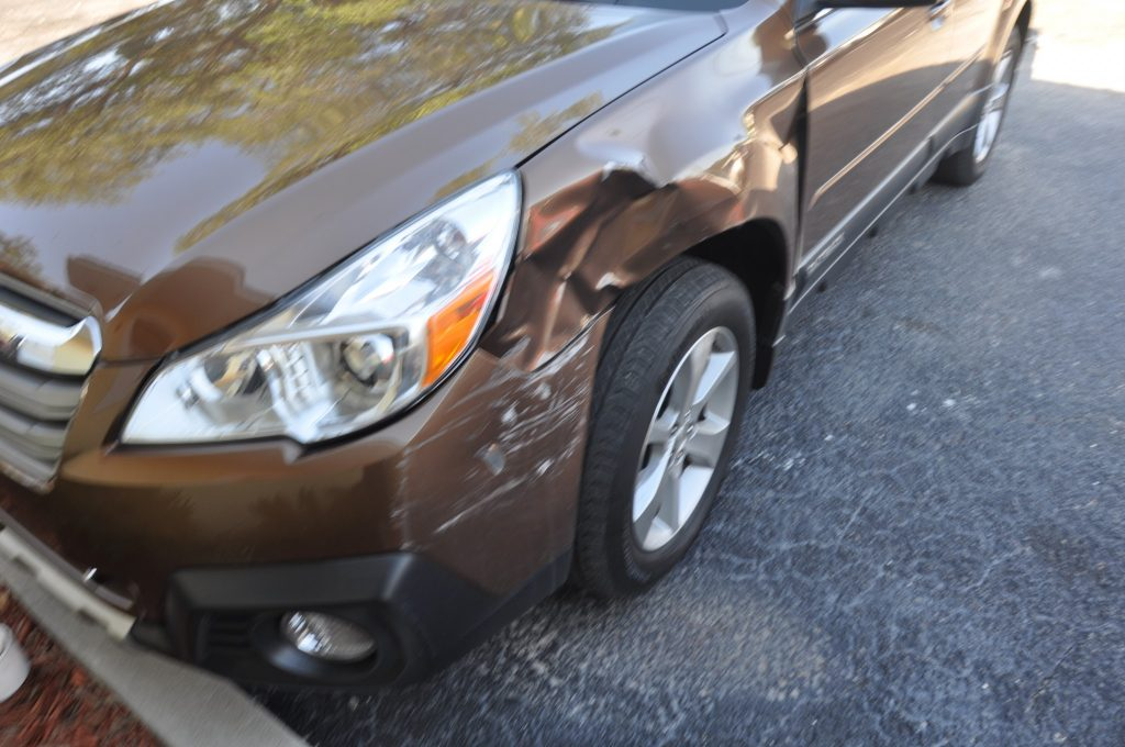 13 Subaru Outback crunched after an auto accident